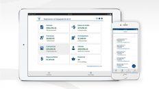 Tablet y celular con software de administración.Calendario de facturación electrónica
